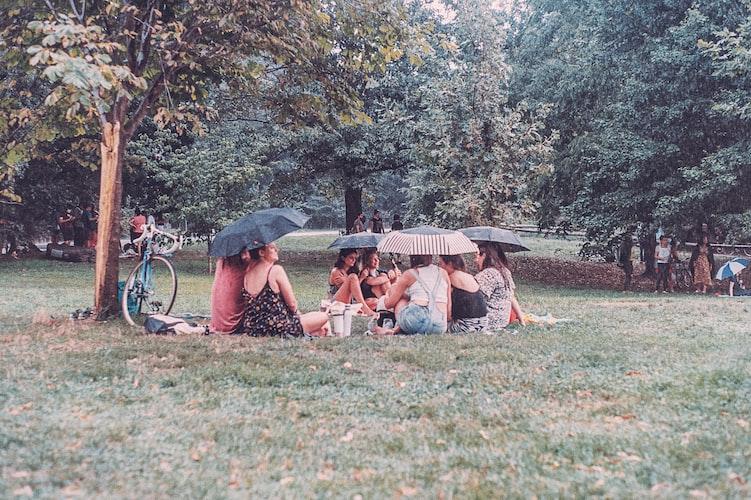 sitting on picnic while its raining