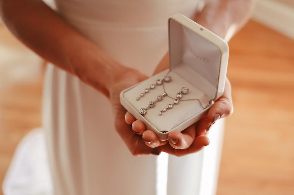 person holding white plastic case