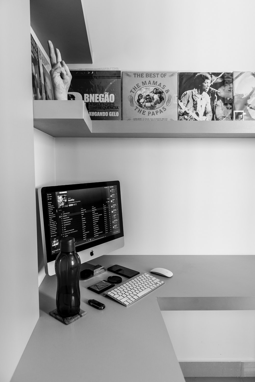 black flat screen computer monitor beside white and black ip desk phone
