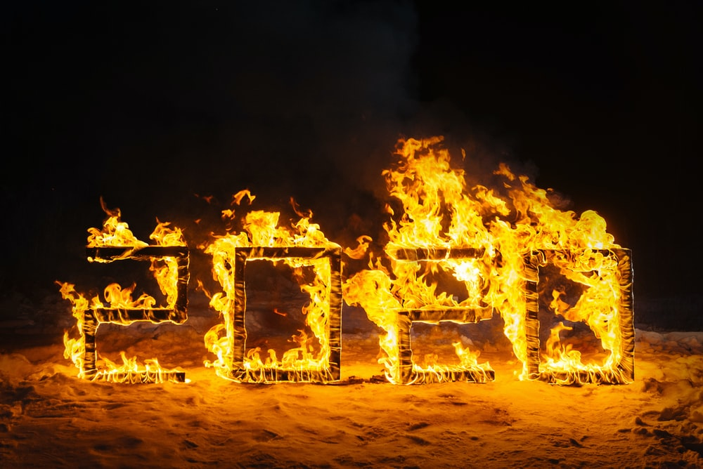 people standing on fire during night time