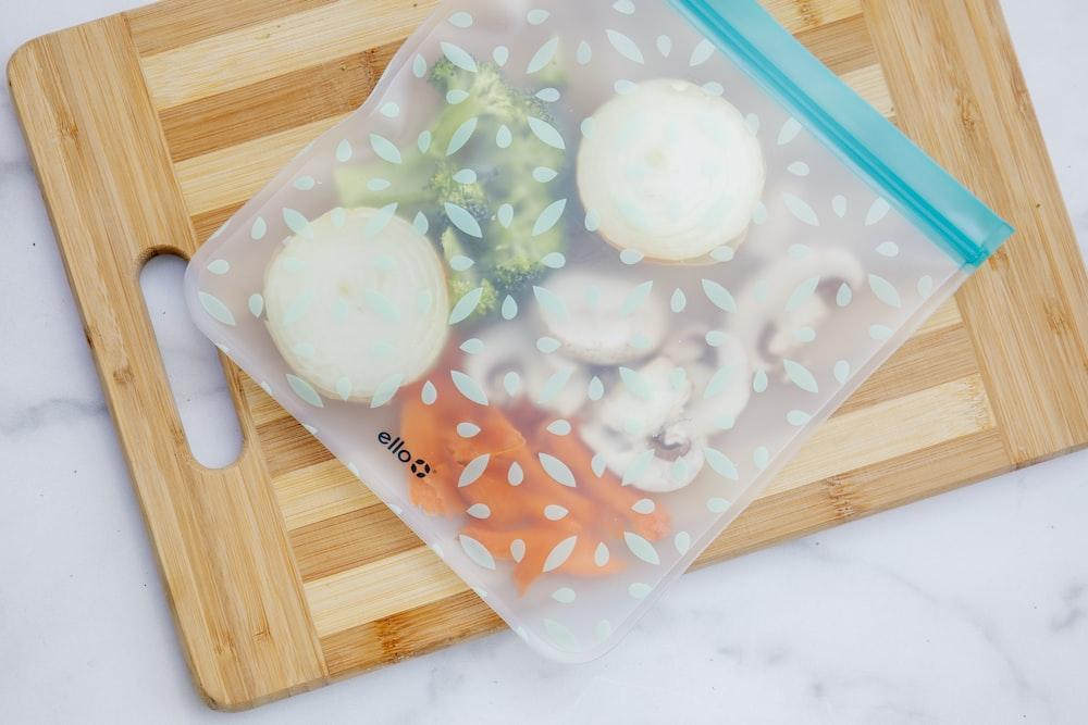 white ice cream on blue plastic container