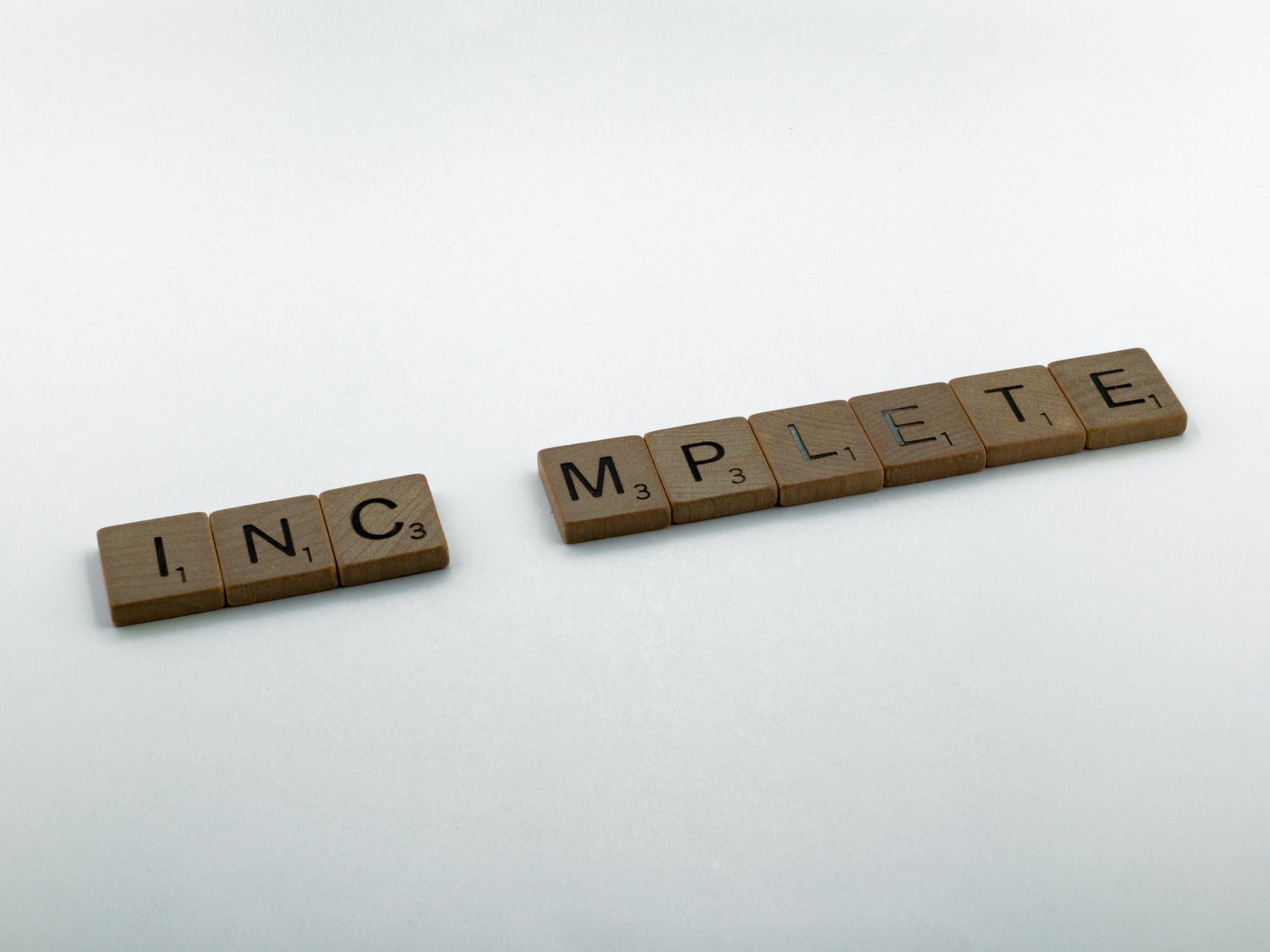 scrabble, scrabble pieces, lettering, letters, wood, scrabble tiles, white background, words, type, typography, design, layout, incomplete, incomplet, imperfect, not finished, finish, lacking, omit,