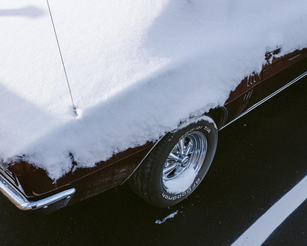 grey car with chrome wheel