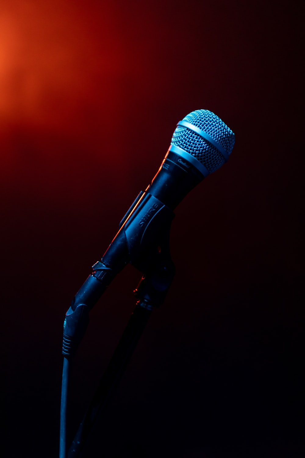 black microphone on black microphone stand