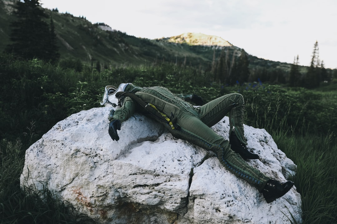 Green and Black Robot On Gray Rock - unsplash