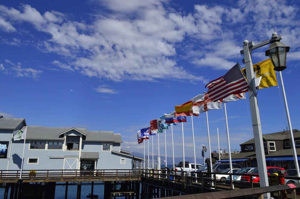 flag of us a on dock under blue sky during daytime