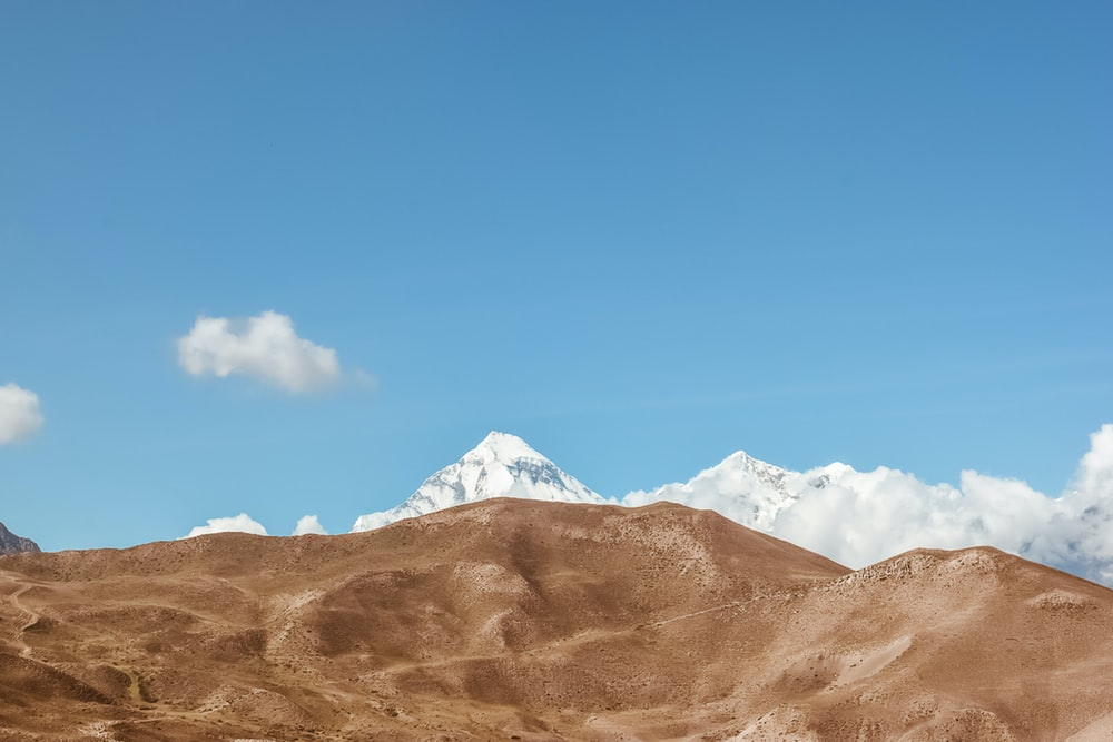 brown and white mountains under blue sky during daytime
