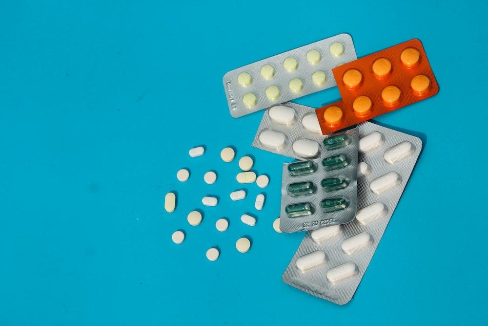 white and orange medication pill blister pack