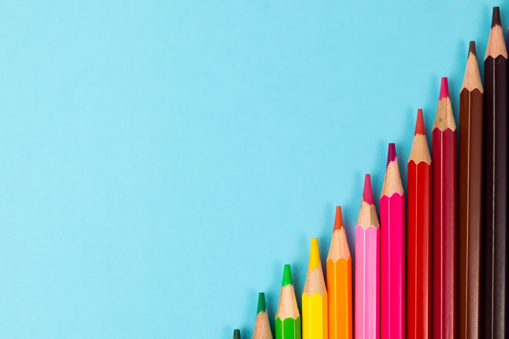 pink yellow green and blue color pencils