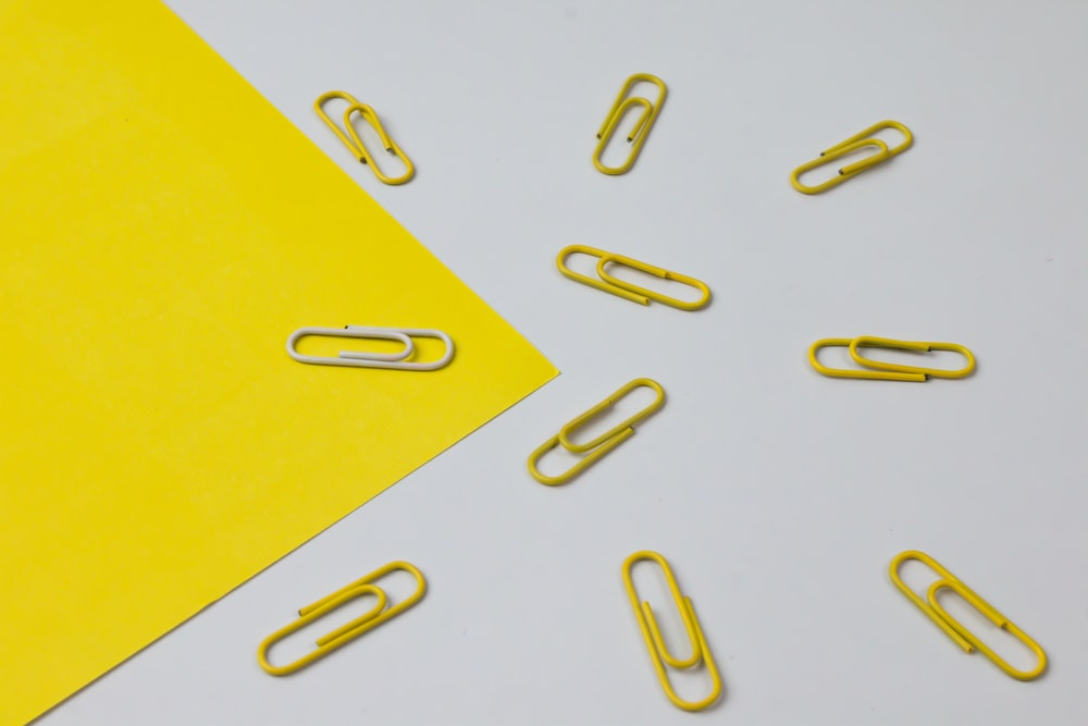 yellow paper with silver paper clip