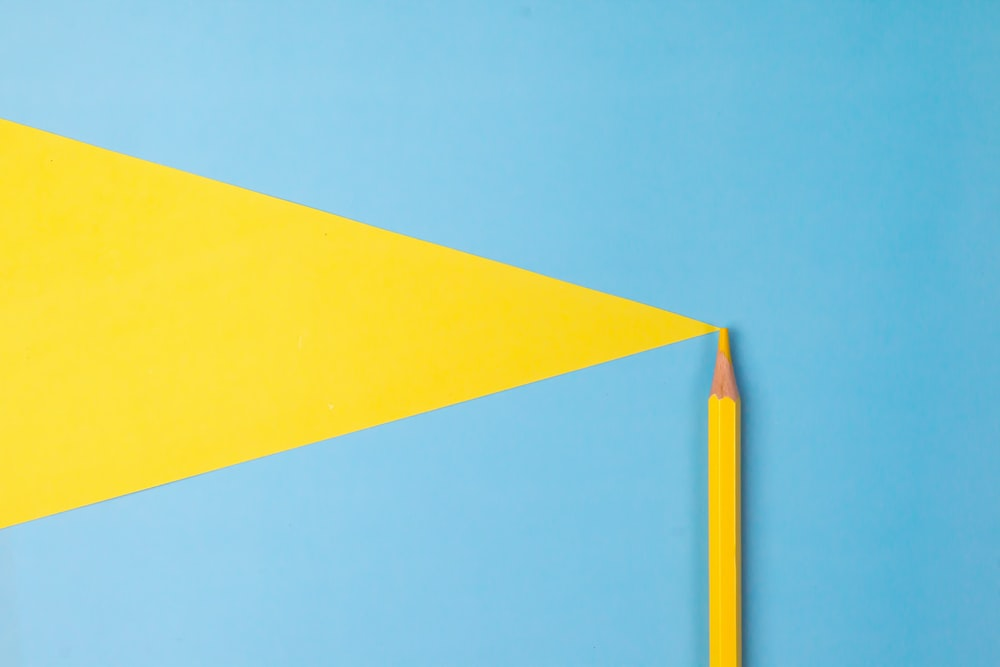 yellow and blue paper on blue surface