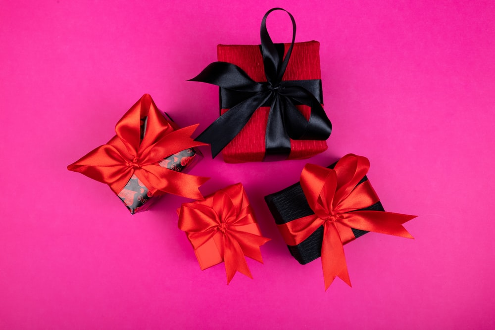 red and black ribbon on pink surface