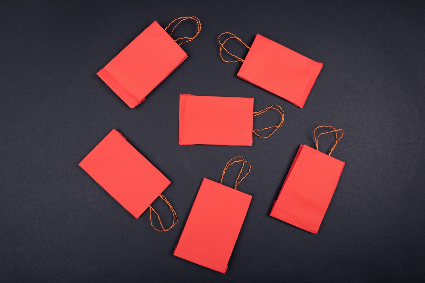 orange paper clip on black surface