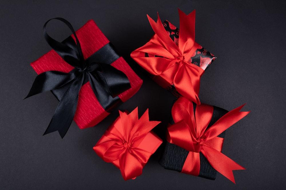 red ribbon on black textile