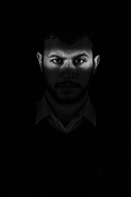 man in black collared shirt