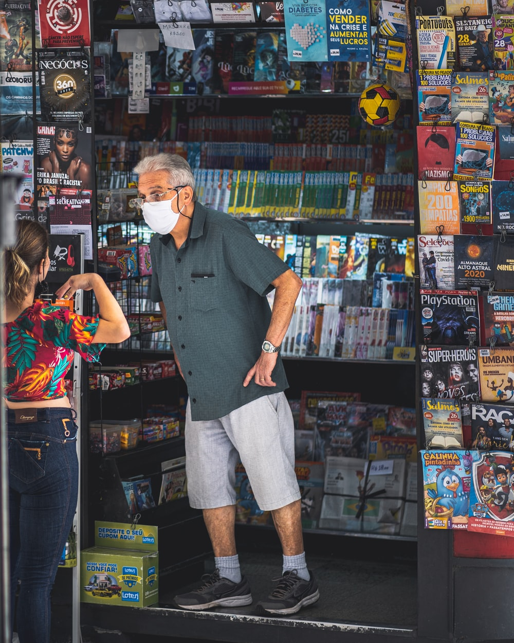 man in black button up shirt standing beside woman in blue sleeveless shirt
