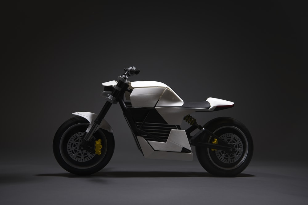 white and black motorcycle with black background