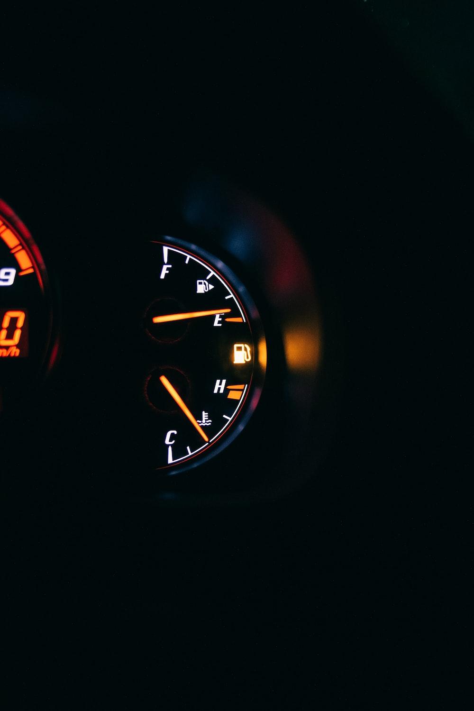 black and red analog speedometer