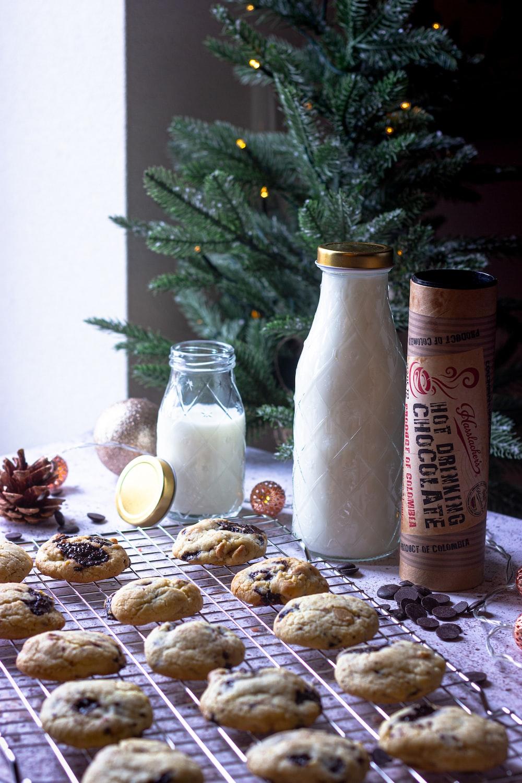 milk in clear glass jar beside cookies and cookies