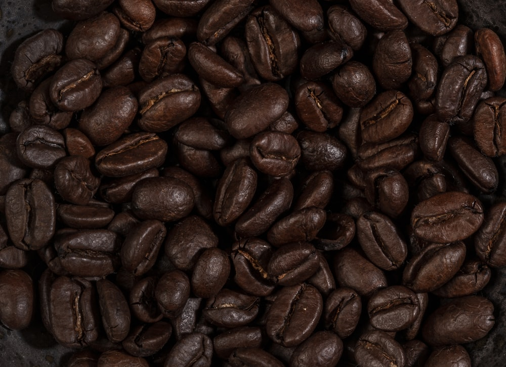 coffee beans on brown wooden table