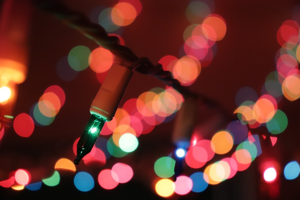 bokeh photography of red and white lights