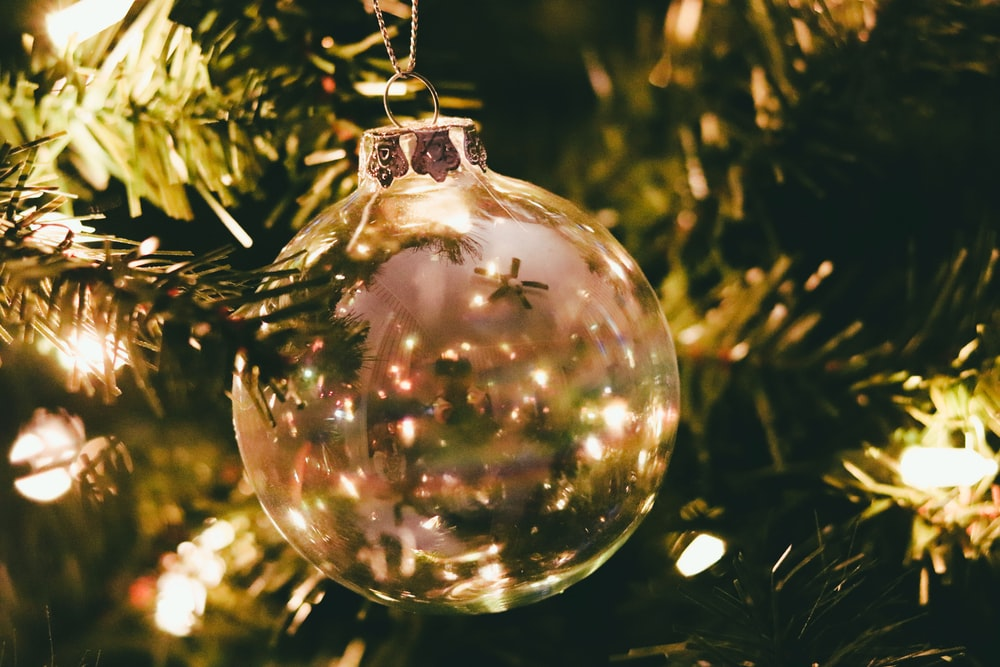 clear glass bauble on green christmas tree