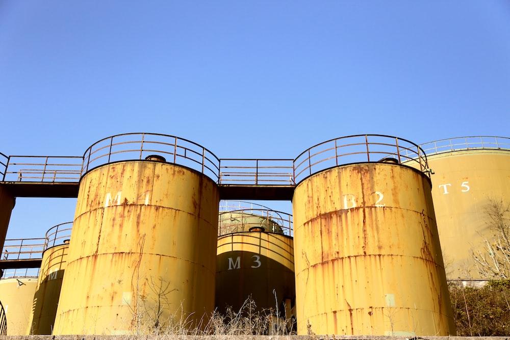 brown steel tank under blue sky during daytime
