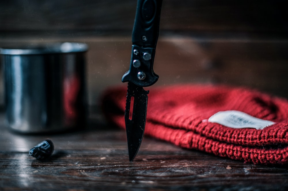 black and silver knife on brown wooden table