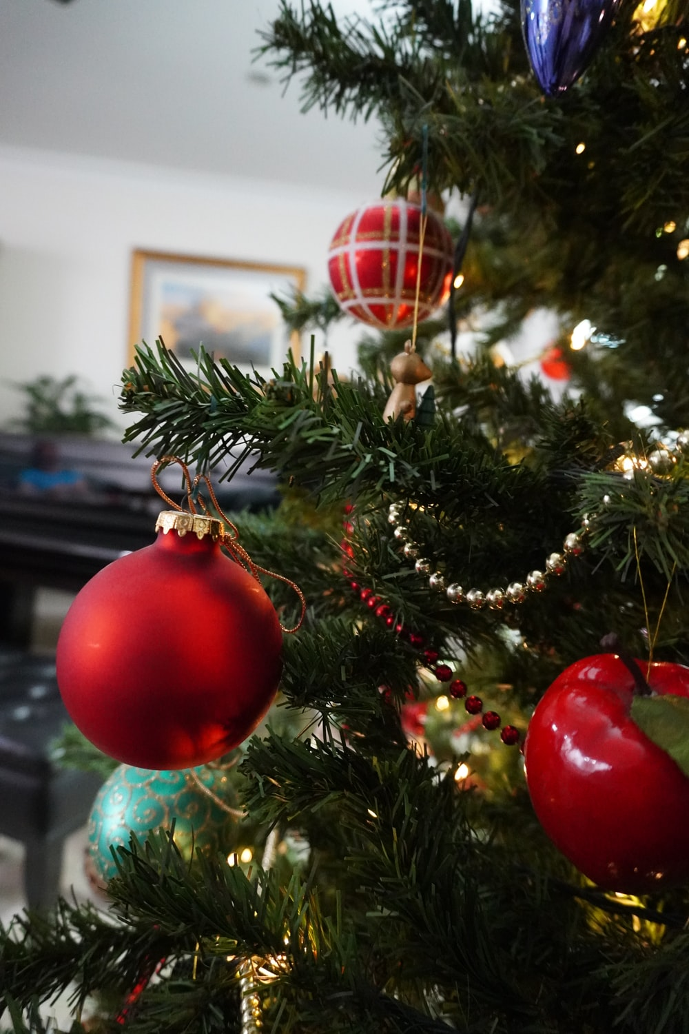 red baubles on green christmas tree