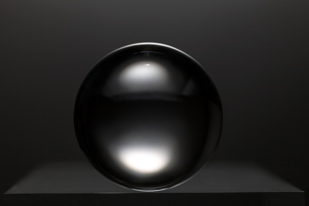 black round ball on white surface
