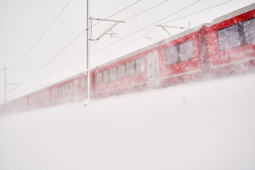 red and white building on snow covered ground