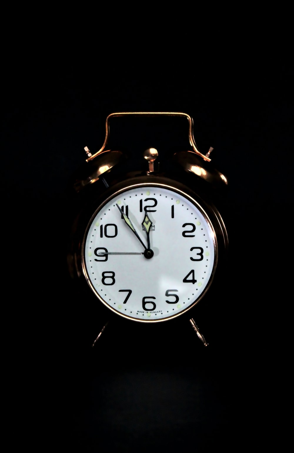 black and white analog alarm clock
