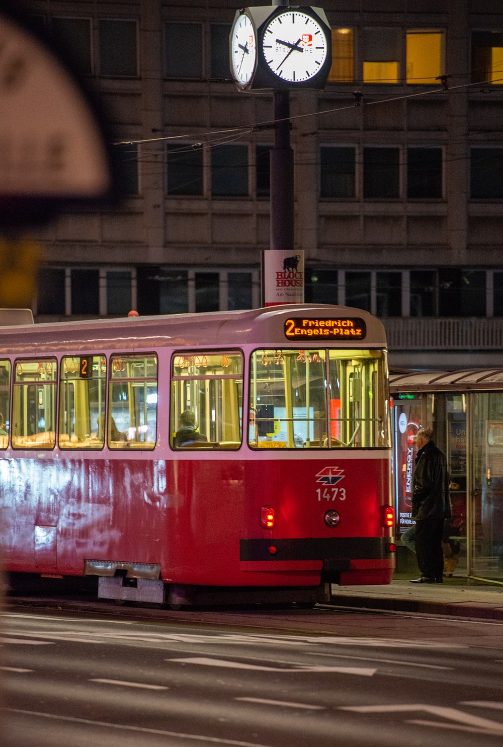red and white tram on the city during daytime