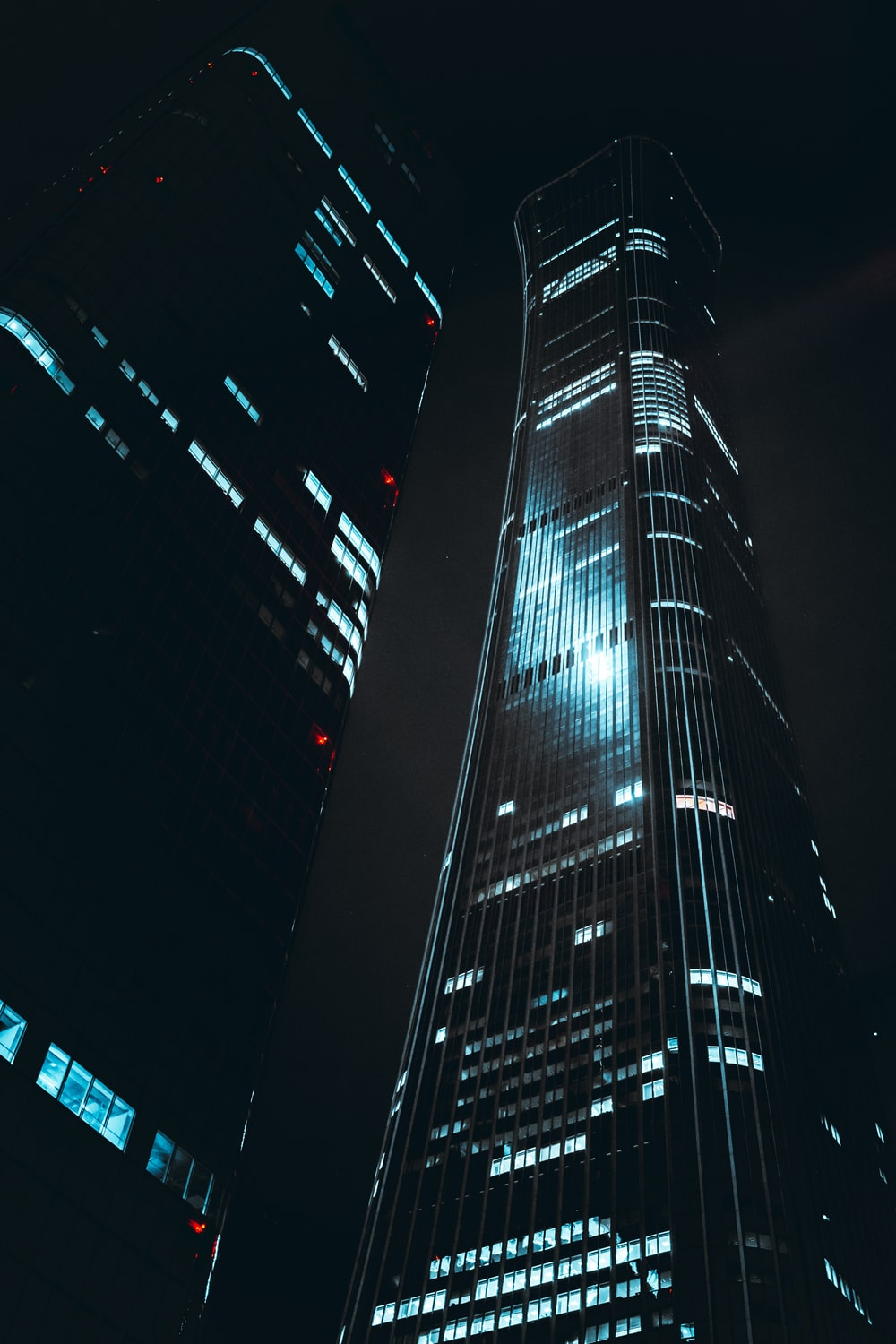 black and blue high rise building