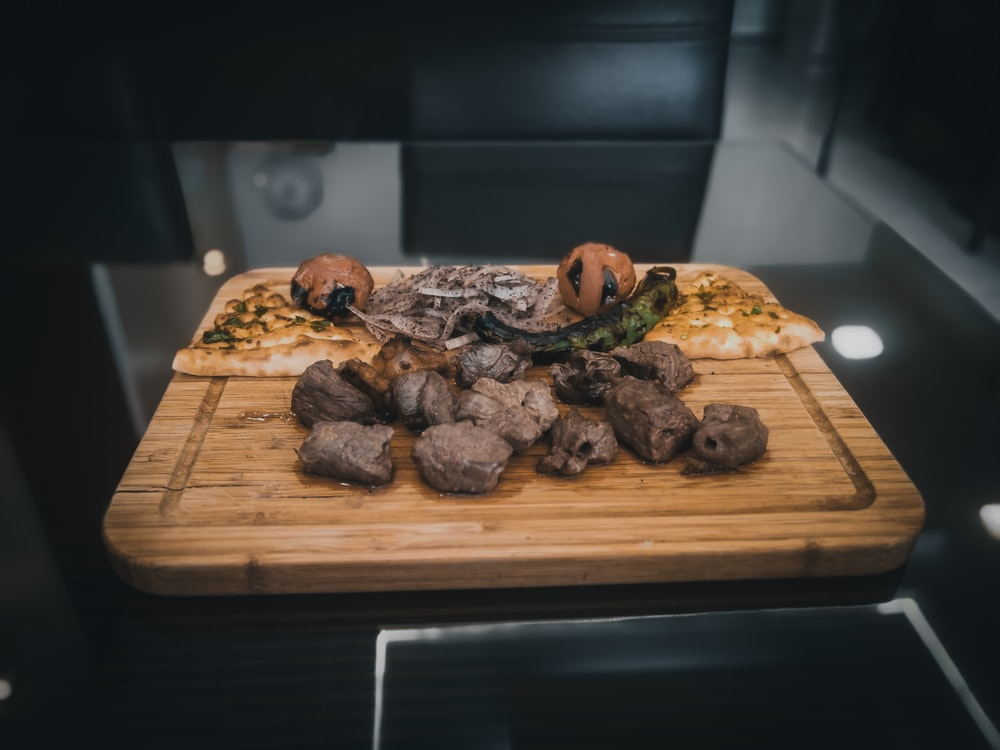 cooked food on brown wooden chopping board
