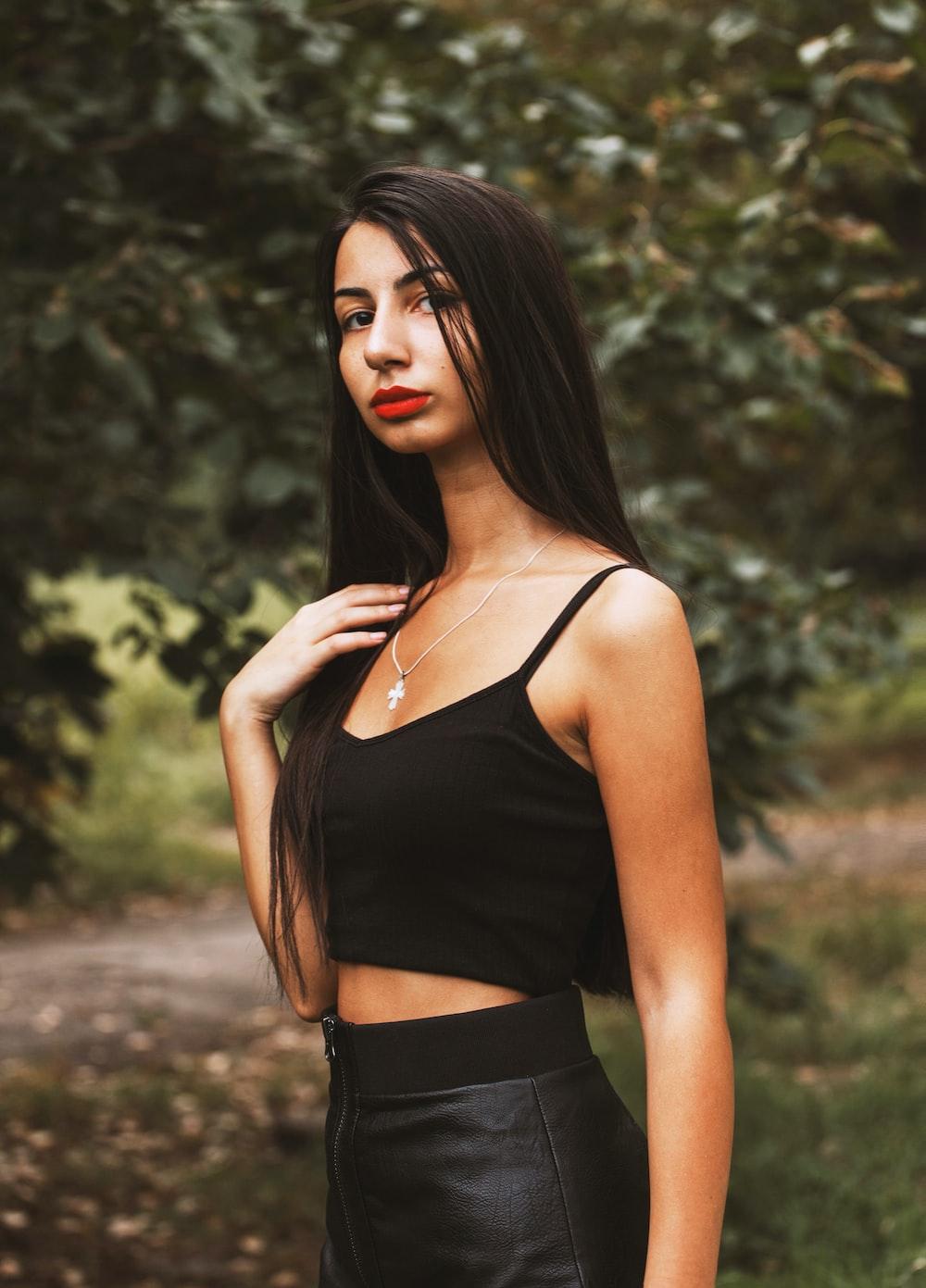 woman in black spaghetti strap top and black bottoms