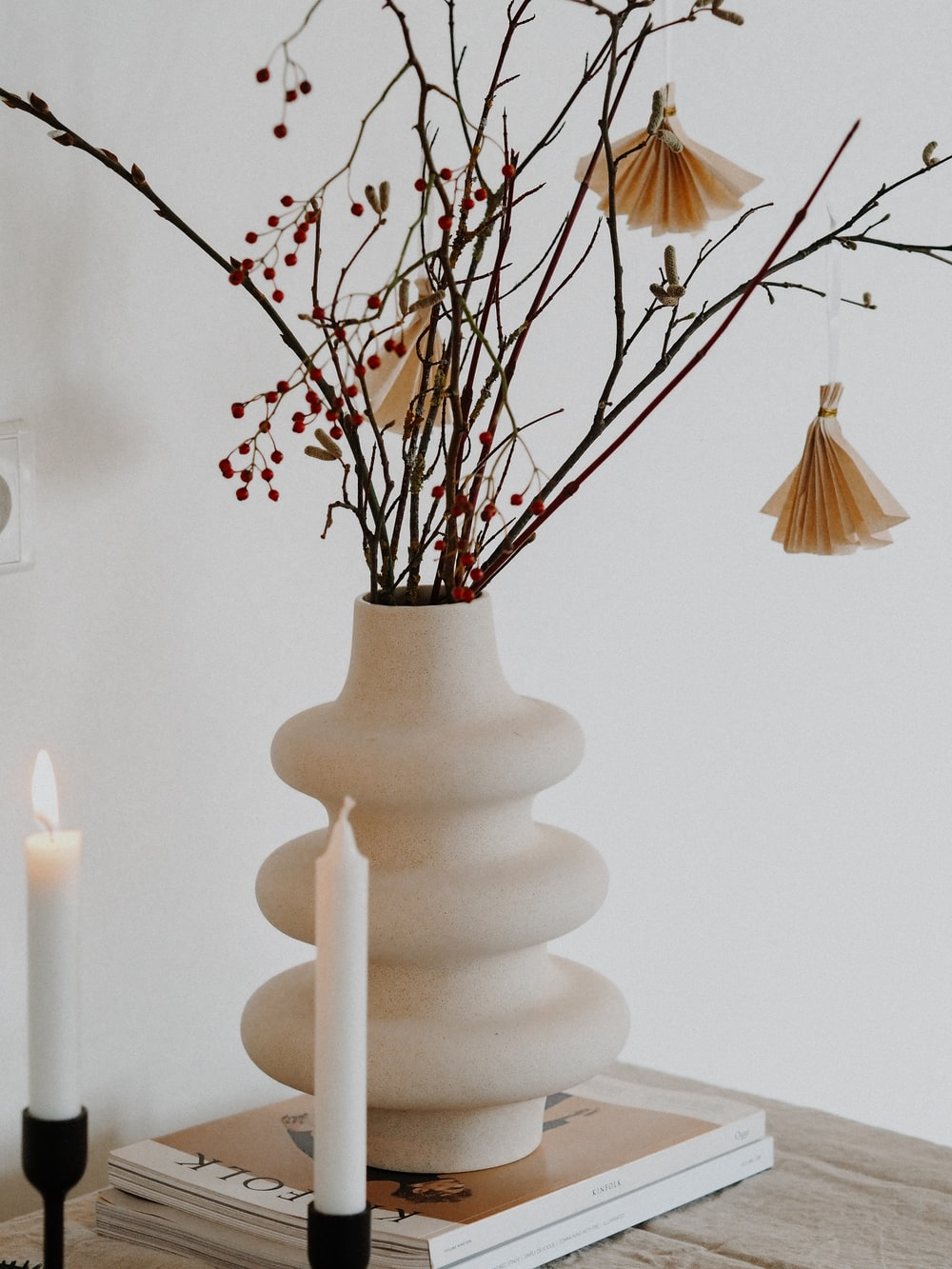 white ceramic vase with candles