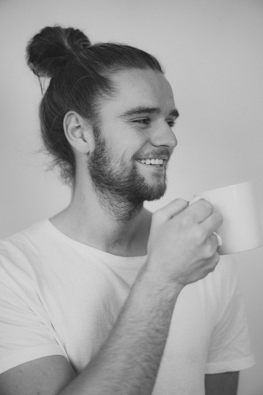 man in white crew neck t-shirt smiling