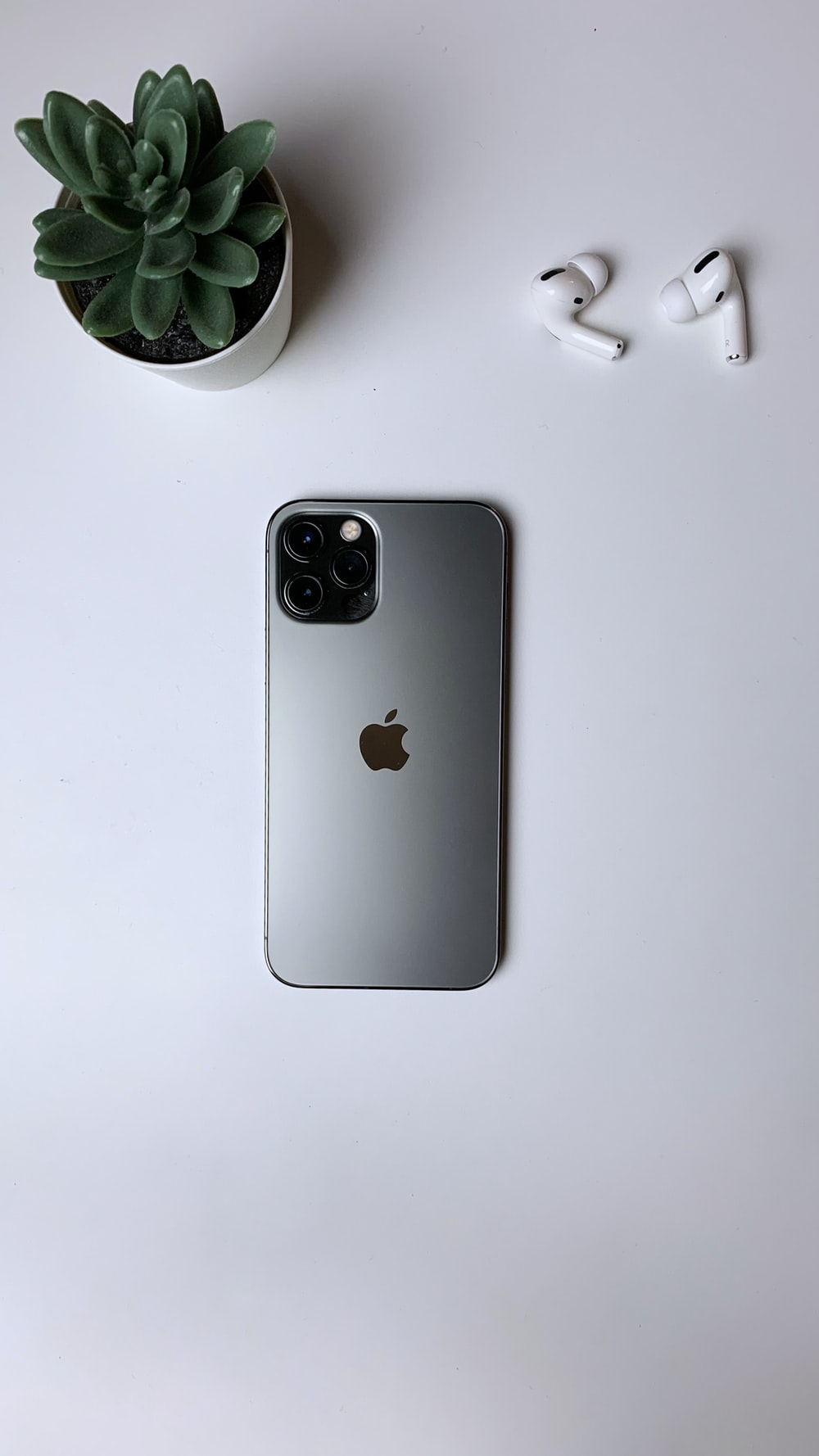 white iphone 5 c on white table