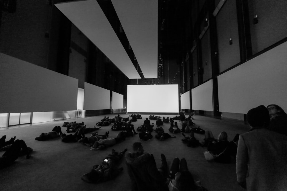 people sitting on floor inside building