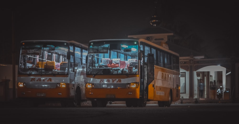 yellow and red bus on road during night time