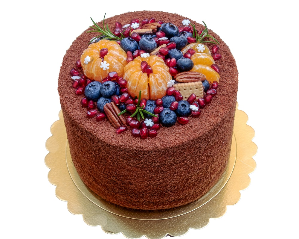 brown cake with assorted color candies