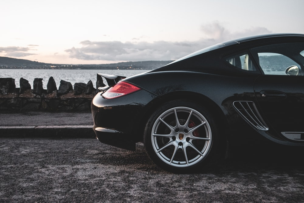 black coupe on gray sand during daytime