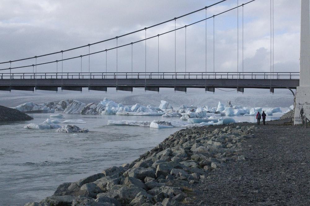 gray bridge over water during daytime