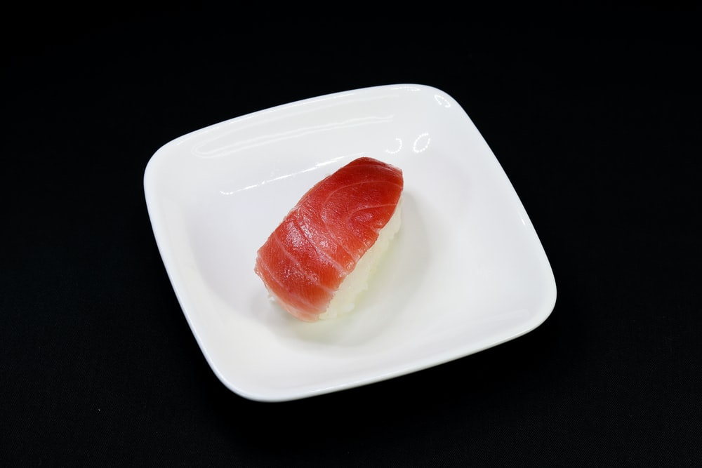 red sliced tomato on white ceramic plate