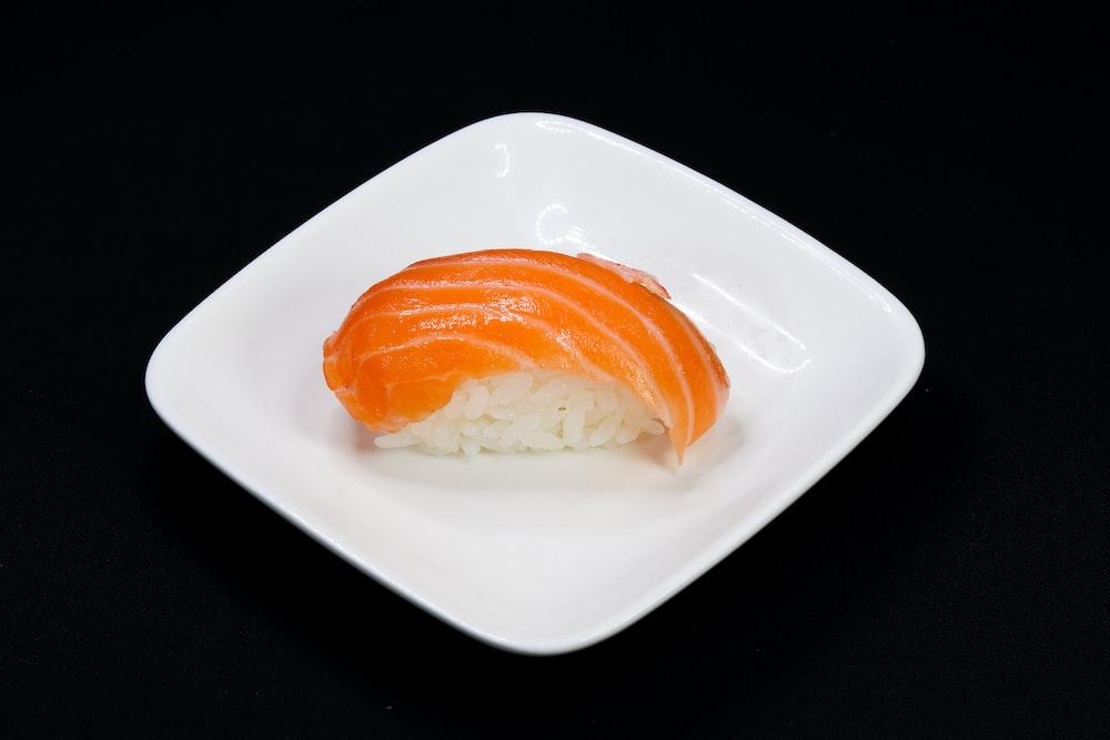 orange and white bread on white ceramic plate