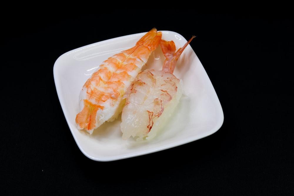 white and yellow shrimp on white ceramic plate