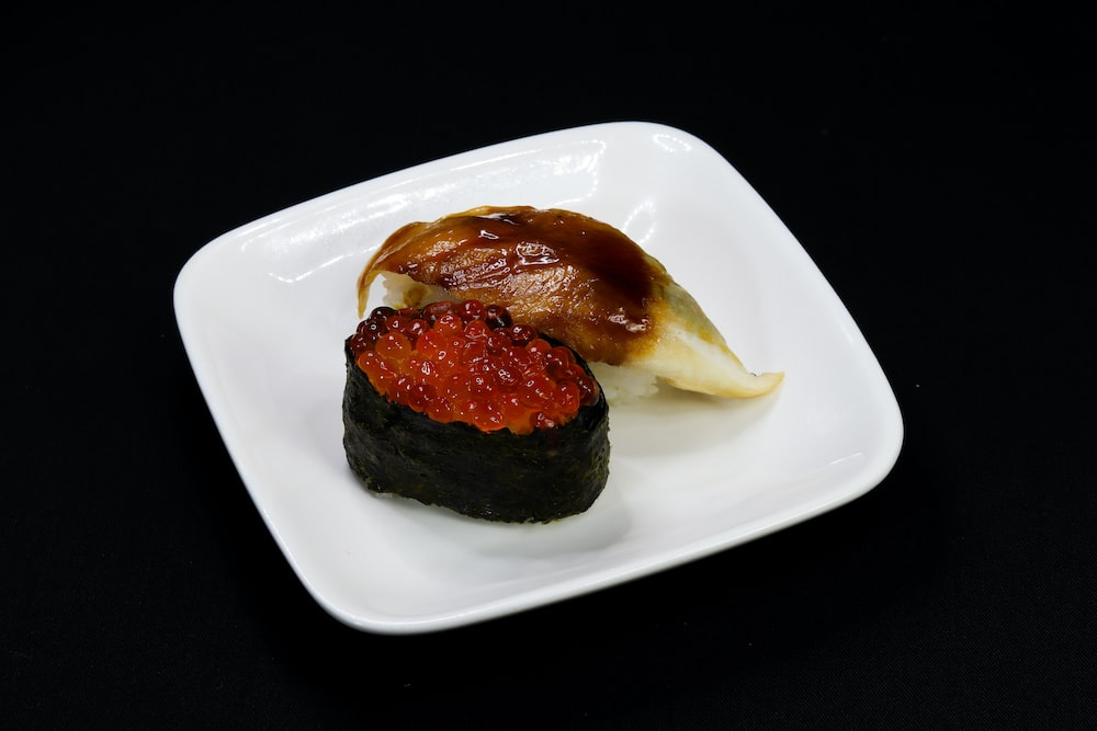 brown and black pastry on white ceramic plate