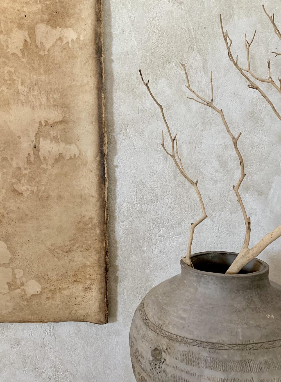 brown tree branch on gray concrete pot