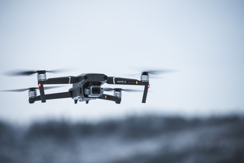 black and white drone in mid air